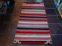 Native American Indian vintage textile, a Navajo double-saddleblanket, c. 1940. The Navajo blanket is visually stunning, and has lovely colors including cochineal red. Main photo.