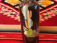 Mexican vintage pottery and ceramics, a beautiful black-ware bottle with exquisite artwork, Tlaquepaque, Jalisco, c. 1930's. Another photo showing the artwork on the sides of the Talquepaque bottle.