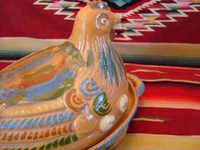 Mexican vintage pottery and ceramics, and Mexican vintage folk-art, a wonderful lidded pottery casserole in the shape of a nesting hen, Tonala or Tlaquepaque, Jalisco, c. 1930's. Closeup photo of one side of the head of the tlaquepaque pottery hen.