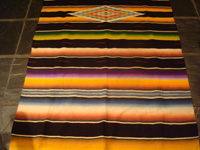 Mexican vintage textiles and Saltillo serapes (sarapes), a beautiful Saltillo serape (sarape), finely wovern, with silk in the center medallion and a very warm pumkin-colored background, c. 1940's.  Another view of part of the Saltillo sarape.