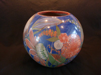 Mexican vintage pottery and ceramics, a large and extremely beautiful burnished globe or vase, with extremely fine and graceful floral artwork, Tonala or Tlaquepaque, Jalisco, c. 1930's. Another side view of the globe vase.