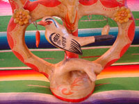 Mexican vintage folk art, and Mexican vintage pottery and ceramics, a very lovely tree-of-life, with wonderful and very colorful hand-painted decorations, Acatlan, Puebla, c. 1940's. It is attributed to the great Heriberto Castillo of Acatlan. Closeup photo of the bird near the base.