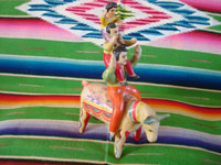 Mexican vintage folk art, and Mexican vintage pottery and ceramics, a wonderful piece of folk art, depicting three acrobats balancing atop a bull, attributed to the great Heron Martinez, Acatlan, Puebla, c. 1950's. Main photo.