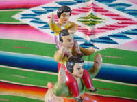 Mexican vintage folk art, and Mexican vintage pottery and ceramics, a wonderful piece of folk art, depicting three acrobats balancing atop a bull, attributed to the great Heron Martinez, Acatlan, Puebla, c. 1950's. Photo of the three balancing acrobats.