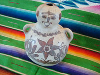 Mexican vintage folk art, and Mexican vintage pottery and ceramics, a pottery figure of a seated person, with wonderful hand-painted decorations in the style of the state of Guerrero, Tulimon, Guerrero, c. 1970. Main photo of the Guerrero figure.