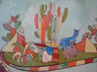 Mexican vintage pottery and ceramics, a lovely pottery plate with a wonderful, pale-green background glaze and very fine artwork, Tonala or Tlaquepaque, Jalisco, c. 1930's. Closeup photo of the Tlaquepaque pottery plate.