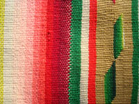 Mexican vintage textiles and Saltillo sarapes, a spectacular Saltillo sarape (serape) with wonderful colors and a whirling-log in the center medallion, Mexico, c. 1910-20's. Another photo showing an edge of the Saltillo sarape.