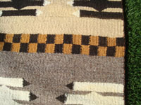 Native American Indian and Navajo rugs and textiles, a beautiful Navajo textile or rug with a lovely revival pattern of decoration, Arizona or New Mexico, c. 1930-40's. Closeup photo of part of the Navajo vintage textile or rug.