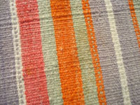 New Mexican antique and vintage textiles, a very fine Rio Grande textile, New Mexico, c. 1880. Closeup photo of the Rio Grande blanket, showing the colors and the tightness of the weave.