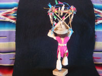Mexican vintage folk art, a wonderful folk art figure of a bull-dancer made of wood, cornhusks, string, straw and ribbons, c. 1950's or earlier. Photo of the back side of the dancer.