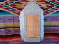 New Mexican vintage devotional art, and New Mexican vintage folk art. a wonderful retablo depicting Our Lady of Guadalupe, done on hand-adzed wood with a surrounding stamped tinwork-art frame, New Mexico, c. 1990. Photo showing the back side of the retabl set in tin.