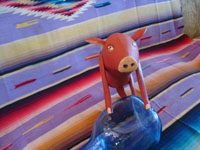 Mexican vintage folk art, and Mexican vintage woodcarving, a carved and painted pig, attributed to the great carver and folk artist, Manuel Jimenez, Oaxaca, c. 1950's. Another frontal view of the pig by Manuel Jimenez of Oaxaca.