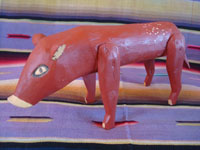 Mexican vintage folk art, and Mexican vintage woodcarving, a carved and painted pig, attributed to the great carver and folk artist, Manuel Jimenez, Oaxaca, c. 1950's. Main photo of the wooden-carved pig attributed to Manuel Jimenez of Oaxaca.