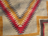 Native American Indian vintage textiles, and Navajo textiles and rugs, a beautiful Red Mesa Navajo rug, c. 1920.  Closeup photo of the eye-dazzler patterns of the Navajo Red Mesa textile or rug.