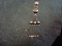 Native American Indian sterling silver jewelry, and Zuni vintage silver jewelry, a lovely pair of Zuni dangling earrings with turquoise, Zuni Pueblo, New Mexico, c. 1930's. Closeup photo of one of the Zuni silver jewelry earrings.