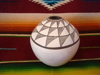 "Native American Indian pottery and ceramics, a lovely pottery seed pot or volcano pot, signed on the bottom, ""Lucy M. Lewis"", Acoma Pueblo, New Mexico, c. 1950. Main photo of the pottery jar by Lucy Lewis of Acoma."
