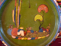 Mexican vintage pottery and ceramics, a wonderul pottery charger with beautiful artwork featuring an endearing Mexican rural village scene, Tlaquepaque or Tonala, Jalisco, c. 1940's. Closeup photo of a part  of the rural scene on the front of the Tlaquepaque pottery charger.