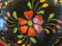 Mexican vintage folk art, a laquer-ware gourd with wonderful decorations, Uruapan, c. 1940's. Closeup photo of the floral decorations of the gourd.