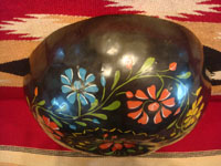 Mexican vintage folk art, a laquer-ware gourd with wonderful decorations, Uruapan, c. 1940's. A side view of the outside of the gourd.