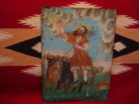 Mexican vintage devotional and folk art, and Mexican vintage tinwork art, a lovely retablo painted on tin depicting San Ysidro el Labrador, San Isidro patron saint of farmers, c. 1930's-1940's, or earlier. Main view of the retablo.