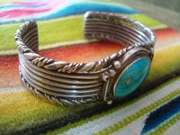 Native American Indian sterling silver jewelry, and Navajo silver jewelry, a very beautiful Navajo bracelet with exquisite silverwork and a wonderul turquoise stone (very possibly blue gem), Arizona or New Mexico, c. 1950's.  A side view of the bracelet.