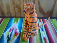 "Mexican vintage folk art, and Mexican vintage woodcarvings and masks, a wonderful carved wooden leopard with beautiful painted decorations, signed on the bottom ""Quirino Santiago Cruz, Etla, Oaxaca"", c. 1970's.  Main photo of the carving."