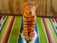 "Mexican vintage folk art, and Mexican vintage woodcarvings and masks, a wonderful carved wooden leopard with beautiful painted decorations, signed on the bottom ""Quirino Santiago Cruz, Etla, Oaxaca"", c. 1970's. Closeup photo of the front of the leopard."