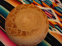 Photo of the bottom of the Mission Indian basket with the tail of the rattlesnake.