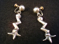 "Mexican vintage sterling silver jewelry, earrings with ""corn pattern"", c. 1940's. Size: 2 1/4"" tall x 3/8"" wide at top. Marked: BGM Hecho en Mexico DF 925. These are very graceful and have wonderful age and patina. Price: $175."