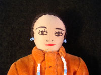 Closeup photo of the face of the second of the pair of Navajo folk art dolls.