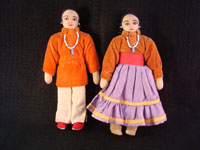 "I-6: Native American Indian folk art, pair of Navajo dolls, c. 1950. Wonderfully dressed in traditional Navajo clothes and jewelry. Faces are stitched (v. painted on). Size: 7"" tall x 4"" wide at waists. Price: $125 for the pair."