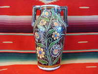 Mexican vintage pottery and ceramics, a pottery tourist jar with handles and fine floral decorations, 1940.