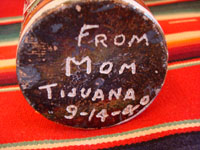 A photo showing the bottom of the Mexican vintage pottery tourist jar with signature.