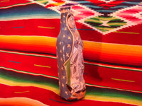 Mexican vintage pottery and ceramics, and Mexican vintage devotional art, a pottery bottle of Our Lady of Guadalupe from Tlaquepaque, c. 1930-40. Side view of bottle.