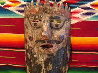 Mexican vintage wood-carving and Mexican vintage folk art, a mask of a European king used in dance celebrations in Apaxtla, Puebla, c. 1920. Closeup photo of the mask.