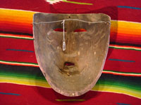 Mexican vintage wood carving and Mexican vintage folk art, a dance mask depicting a European woman, from Guerrero, c. 1930-40. Photo showing the back side of the mask.