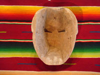 Guatemalan vintage wood-carving and folk art, a carved wooden mask used in dances, Guatemala, c. 1940's. Photo of the back side of the mask.