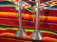 Mexican vintage tin-work art (tin-art), a pair of candlestick holders with fine stamping and tin dangles, c. 1940's. Main photo.