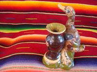 Mexican vintage pottery and ceramics, and Mexican vintage folk art, a pottery duck standing next to a lovely blackware vase, from Tlaquepaque, Jalisco, c. 1930's. A photo of the back side of the duck.
