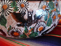 Mexican vintage pottery and folk art, a lovely petatillo casserole with lid, Tonala, Jalisco, c. 1950-60, by famed artist Jose Bernabe. The casserole features wonderful and very intricate floral and zoomorphic figures. Closeup photo.