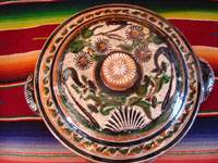 Mexican vintage pottery and folk art, a lovely petatillo casserole with lid, Tonala, Jalisco, c. 1950-60, by famed artist Jose Bernabe. The casserole features wonderful and very intricate floral and zoomorphic figures. Photo from above the casserole.