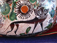 Mexican vintage pottery and folk art, a lovely petatillo casserole with lid, Tonala, Jalisco, c. 1950-60, by famed artist Jose Bernabe. The casserole features wonderful and very intricate floral and zoomorphic figures. Closeup photo of a lion decoration the petatillo cassserole.