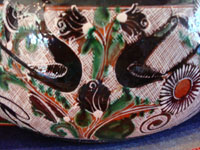 Mexican vintage pottery and folk art, a lovely petatillo casserole with lid, Tonala, Jalisco, c. 1950-60, by famed artist Jose Bernabe. The casserole features wonderful and very intricate floral and zoomorphic figures. Another closeup photo of animals decorating the casserole.