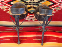 Mexican vintage iron-work, a pair of wrought-iron sconces, to be used as candleholders or which can be wired for electric lights, c. 1950. Main photo of the Mexican sconces.