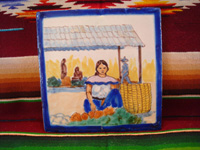 Mexican vintage pottery and ceramics, a lovely Talavera tile, probably from the famous Uriarte fabrica, Puebla, c. 1940's. The scene on the tile is a lovely woman in a beautiful Mexican village. Main photo of the tile.