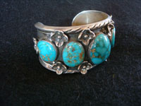 Native American Indian sterling silver jewelry, and Navajo sterling silver jewelry, a beautiful Navajo silver bracelet with spectacular turquoise and excellent silver work, Navajo (Arizona or New Mexico), c. 1960's. Photo showing a side of the Navajo silver bracelet.