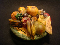 Mexican vintage folk art, and Mexican vintage pottery and ceramics, a pottery bank in the form of a lovely bowl of assorted fruits, Tonala or Santa Cruz de las Huertas, Jalisco, c. 1930's. Main photo of the fruit bowl bank.