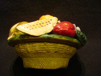 Mexican vintage folk art, and Mexican vintage pottery and ceramics, a pottery bank in the form of a lovely bowl of assorted fruits, Tonala or Santa Cruz de las Huertas, Jalisco, c. 1930's. Another side view of the pottery bank.