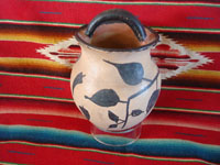Native American Indian vintage pottery and ceramics, a lovely Cochiti pot with one handle and a beautiful naive floral design, Cochiti Pueblo, New Mexico, c. 1930's. Main view of the Cochiti pottery vase with a handle at the top.