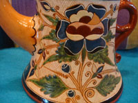 Mexican vintage pottery and ceramics, a very rare and beautiful tea-set, signed by the famous Tonala potter Magdaleno Coldivar Ramos, Tonala, c. 1920-30's. A closeup photo showing the detailed artwork decorating the pot.